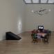 芸術の為の三部作 2008 ヴィデオ、テーブル、椅子、布、鉄、ベルトコンベアー、音響、照明、鉄砲